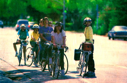 """Students of Diana Lewiston's bicycle safety class listen for instructions from Lewiston via walkie-talkie."" June 1, 1988, San Jose Mercury News, California. Photo by Paul Kitagaki Jr."