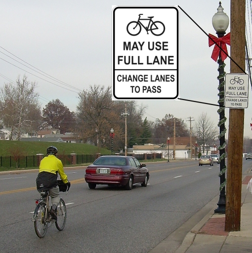 New street signs in Ferguson reflect greater lane leeway for cyclists. Credit: Martin Pion
