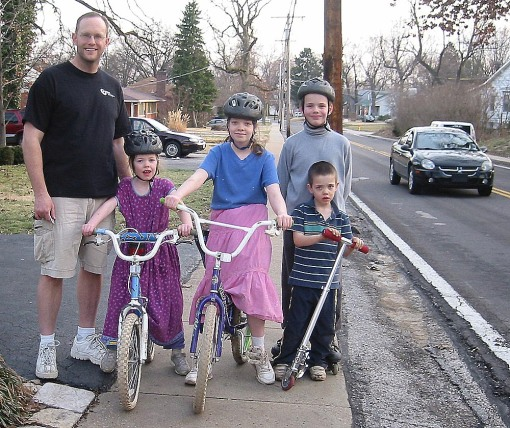 The Morris family, kindly posing for me: one shoed, two on bikes, one on in-line skates with little brother in front with his Razor kick scooter.