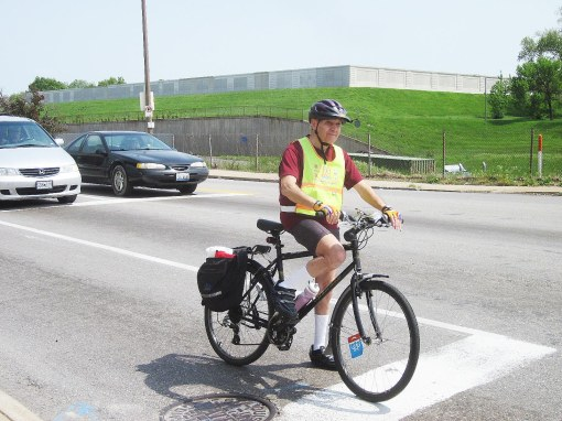 "The author shown controlling the curb lane during the CyclingSavvy St. Louis ""Tour of the City"" training ride in April, 2011.  Photo: Karen Karabell"