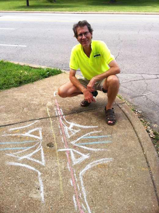 "Fig. 3: Cline demonstrating ""chalk talk"" during the CyclingSavvy on-road instructor training session in downtown St. Louis in July, 2011."