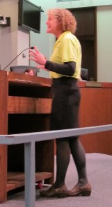 An animated Karen Karabell addresses county council members