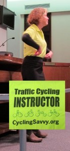Karen turns to show CyclingSavvy logo (inset) on shirt back to council members