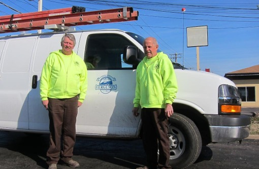 Dennis and Mark pose after installation